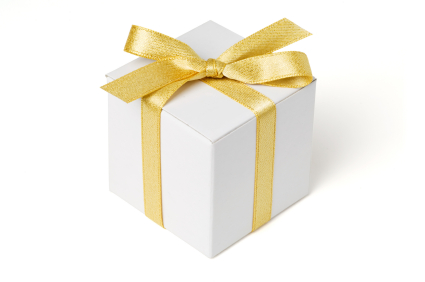 White gift box and gold bow