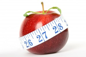 Cherry red summer apple with measuring tape
